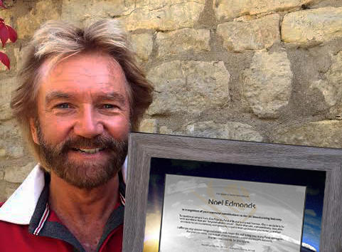Award to Noel Edmonds.